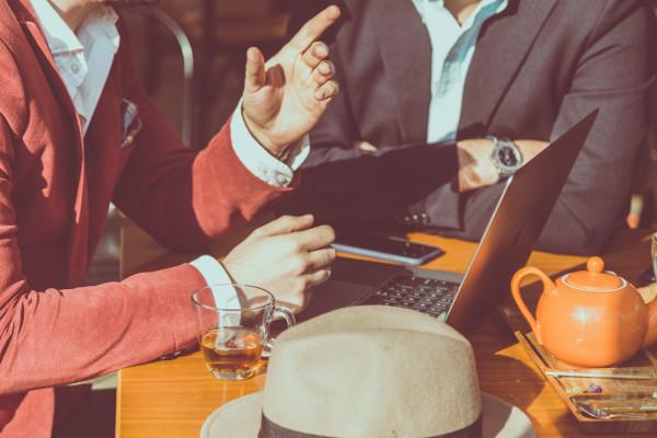 Business Meeting - Photo by Hiva Sharifi on Unsplash